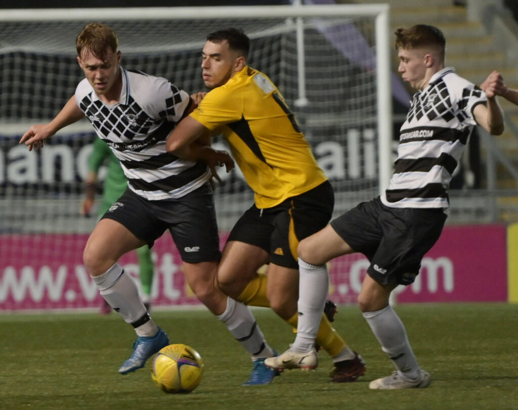 Fort's Marios Avraam sandwiched between Shire's Tyler Fulton and Kenny Barr as he defends the goalmouth. Photograph: Iain Ferguson, alba.photos.