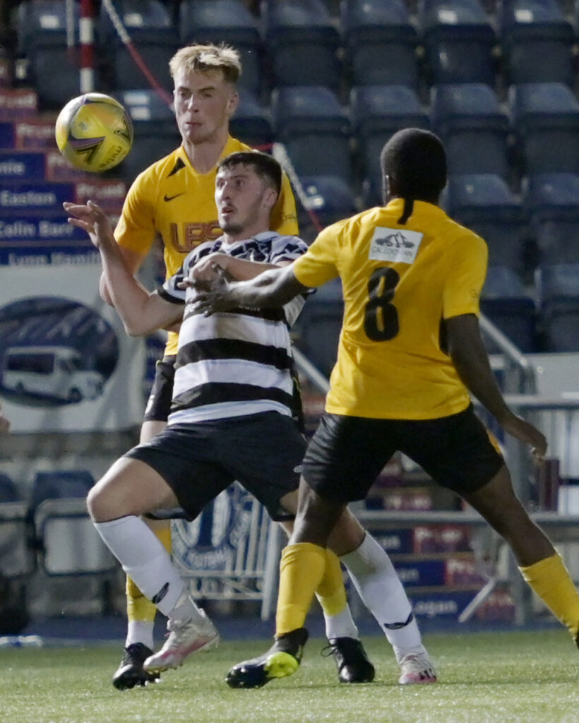 Fort's  Jamie McConnell and Darren Brew sandwich a Shire opponent. Photograph: Iain Ferguson, alba.photos.