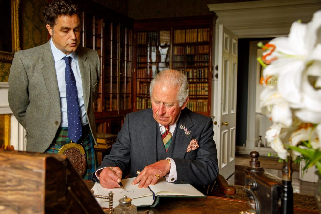 Prince Charles signs the visitors book at Dunvegan. Photograph: Rosie Woodhouse