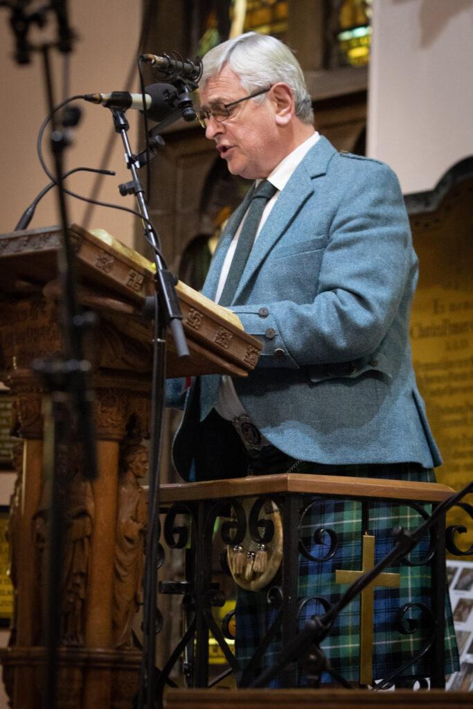 Allan Campbell (Ailean Caimbeul) President of An Comunn Gàidhealach, recites the poem, Ortha Crann nan Teud by Sandy Macdonald Jones -(Sandaigh NicDhòmhnaill Jones) at The Royal National Mòd, 2021 Annual Church Service