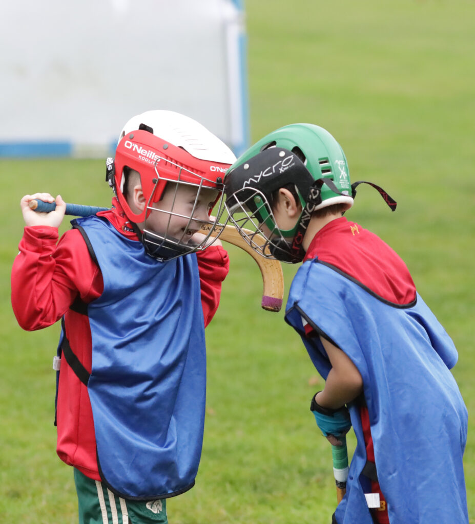 Gaelic Medium shinty Coaching Session taking place prior to the men and women's Mod Shinty Cup matches at Bught Park Inverness at The Royal National Mòd 2021 in Inverness, Scotland