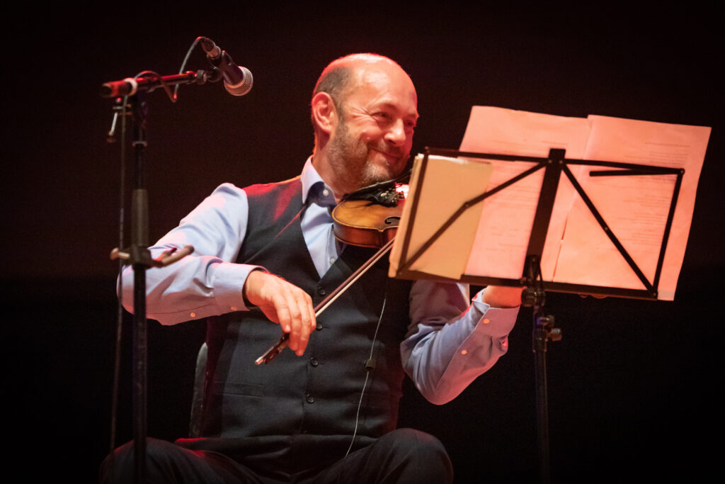 Iain MacFarlane of Glenfinnan Ceilidh Band performs on stage at Eden Court Theatre on the openng night of live music, The Royal National Mòd 2021