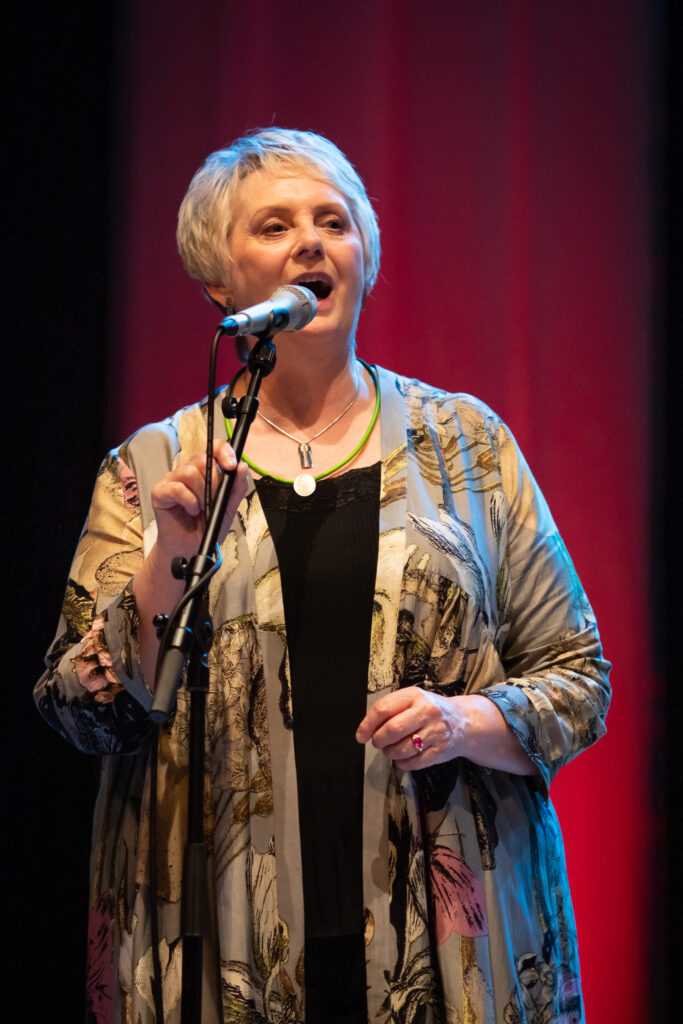 Special guest Gaelic singer, Margaret Stewart sings with Glenfinnan Ceilidh Band  on stage at Eden Court Theatre on the openng night of live music, The Royal National Mòd 2021