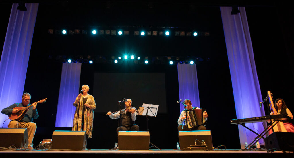 Glenfinnan Ceilidh Band perform on stage awith special guest Gaelic singer, Margaret Stewart Eden Court Theatre on the openng night of live music, The Royal National Mòd 2021