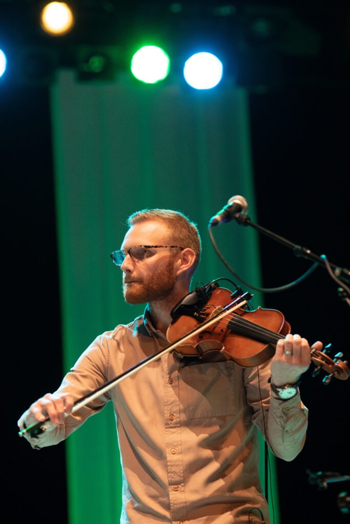 New Glasgow traditional music outfit, Staran, open The Royal National Mòd 2021 in Inverness with a live performance at Eden Court Theatre, Jack Smedley plays fiddle on stage