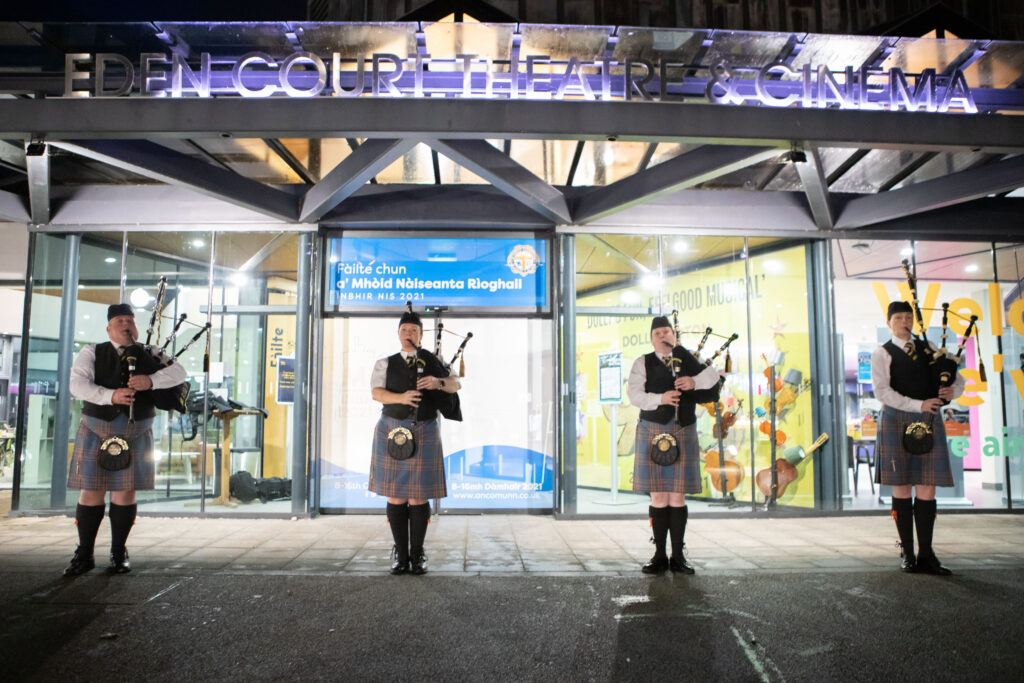 Members of City of Inverness Pipe Band warmly welcome live audiences to Eden Court Theatre for the opening night of The Royal National Mòd 2021 in Inverness
