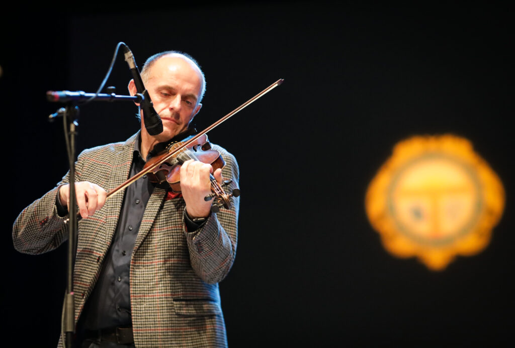 Duncan Chisholm performing on stage  at the special Our Language, Our Music concert