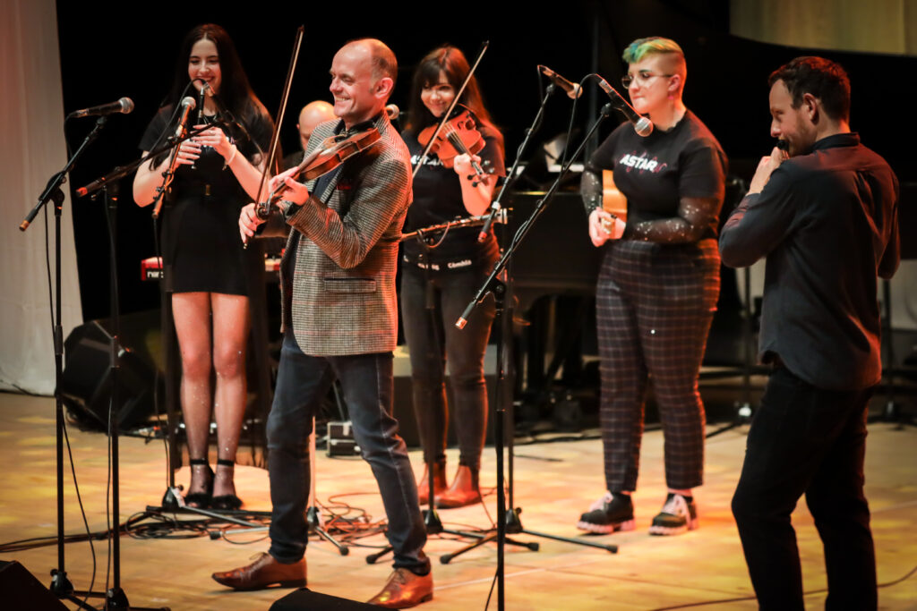 Picture shows Duncan Chisholm, James Duncan Mackenzie and members of Astar performing on stage at the special Our Language, Our Music concert