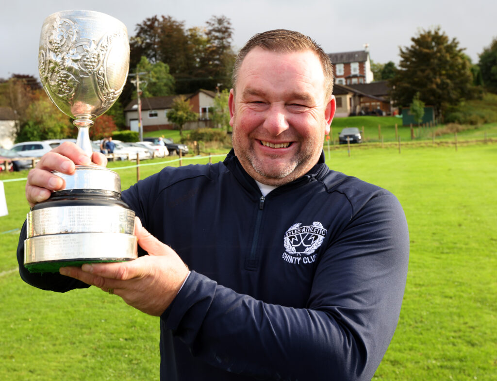 Kyles Athletic manager Robert Baxter cannot hide his delight at getting his hands on his first trophy, the Glasgow Celtic Society Cup. Photograph: Kevin McGlynn.
