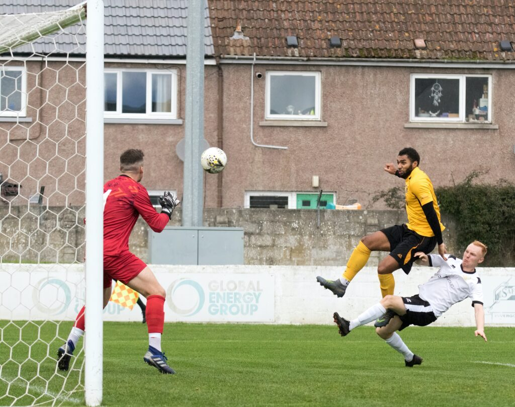 Robbie Foster gets past Clach defender Calum Black and puts the ball past Clach keeper Martin MacKinnon. Photograph: Donald Cameron.