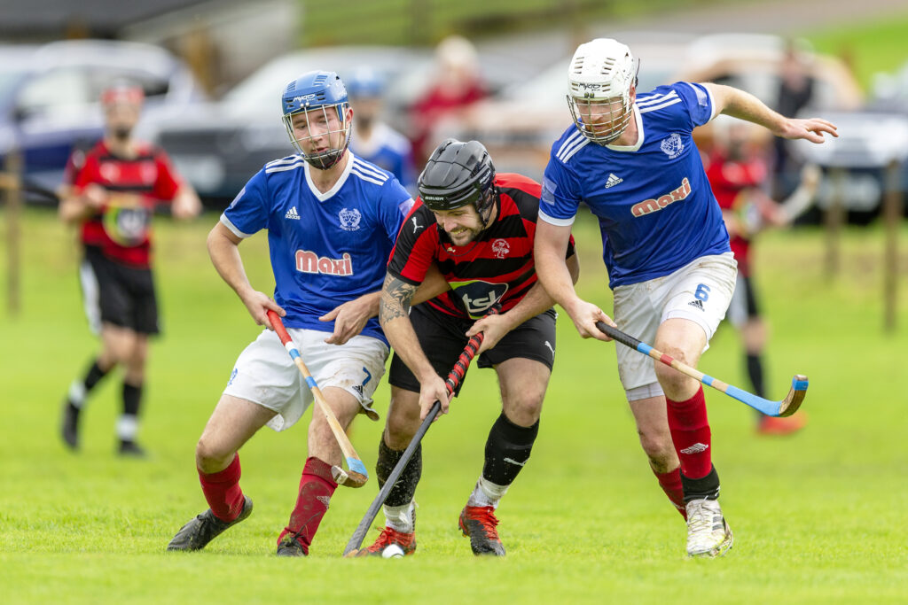 Oban's Daniel Cameron, centre, gets sandwiched by Ross Macrae, left, and Innes MacDonald, both Kyles. Photograph: Neil Paterson.
