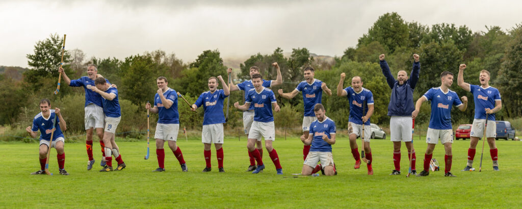 The Kyles Athletic team celebrate Roddy MacDonald's winning penalty in the shoot out. Photograph: Neil Paterson.