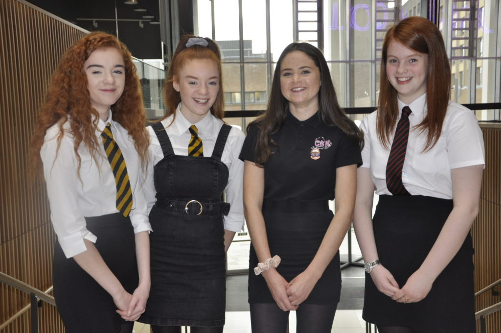 Girls all smiles after overcoming Mòd solo singing nerves