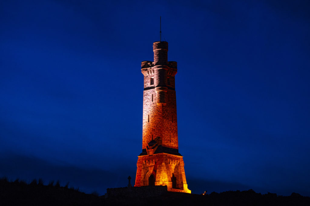 Lewis war memorial turns red for Remembrance Day