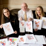 Judges Jodie Jordan and Sophie Kerr, from Ferguson Transport and Shipping, together with Rotarian Ken Johnston sift through the record number of entries. No F47 elves