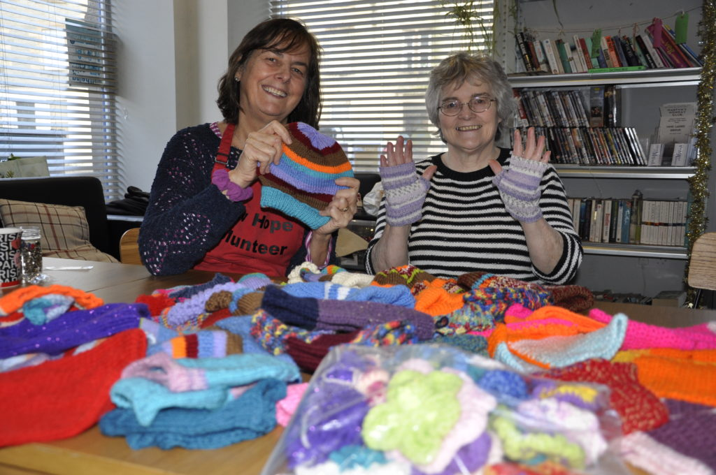 Annie Acton and Beth Campbell from Hope Kitchen with some of the knitwear. 17_t50_HopeKnits01