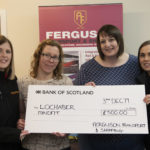 Carly Ferguson (left) and Jody Jordan of Ferguson Transport present a cheque for £500 to Susan Archibald (second from left) and Sharon Wells of MindFit at their base in the Ben Nevis Estate. Photograph, Iain Ferguson, alba,.photos NO F49 MINDFIT DONATION