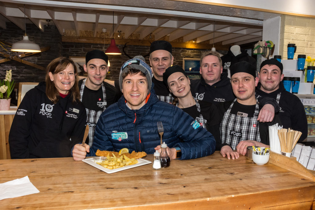 Radio 1 DJ, Greg James, alongside staff at The Real Food Cafe in Tyndrum. NO_T12_Greg James01