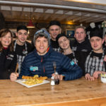 Radio 1 DJ, Greg James, alongside staff at The Real Food Cafe in Tyndrum. NO_T12_Greg James01