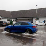 The flooded car park around six inches deep in water in places, is hindering shoppers from using the Co-op and other business in the Caol's Kilmallie Road shopping area. Photograph: Iain Ferguson, alba.photos NO F02 CAOL CAR PARK FLOODING 01