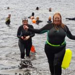 Our correspondent Nic Goddard emerges from Loch Sunart after the loony dook. NO F02 Nic Goddard in NY swim