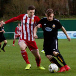 Graeme Rodger (Formartine) and Fort's Jordan Morrison tussle for the ball. Photograph: Phil Harman. NO F03 FORMARTINE V FORT FC 02