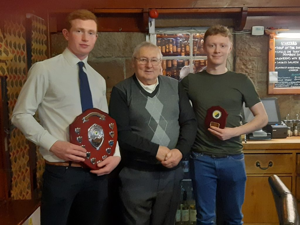 Nick Dalgety, left, holding the shield with Alan MacDonald centre and Archie Johnstone. NO F03 Glengarry shinty 01