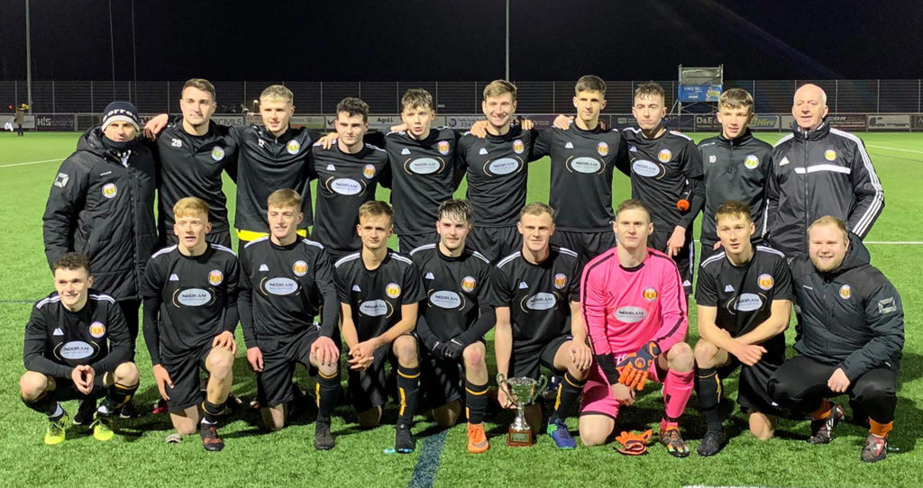 The Fort William FC team with the trophy. Photograph: Duncan MacPherson. NO-F04-FORT-FC-WITH-TROPHY.jpg