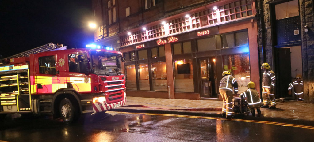 Fire crews set up pumps to remove water from Bar Rio and the Columba Hotel, Oban. Photograph: Kevin McGlynn. NO-T03-storm-brendan_bar-rio2_KM