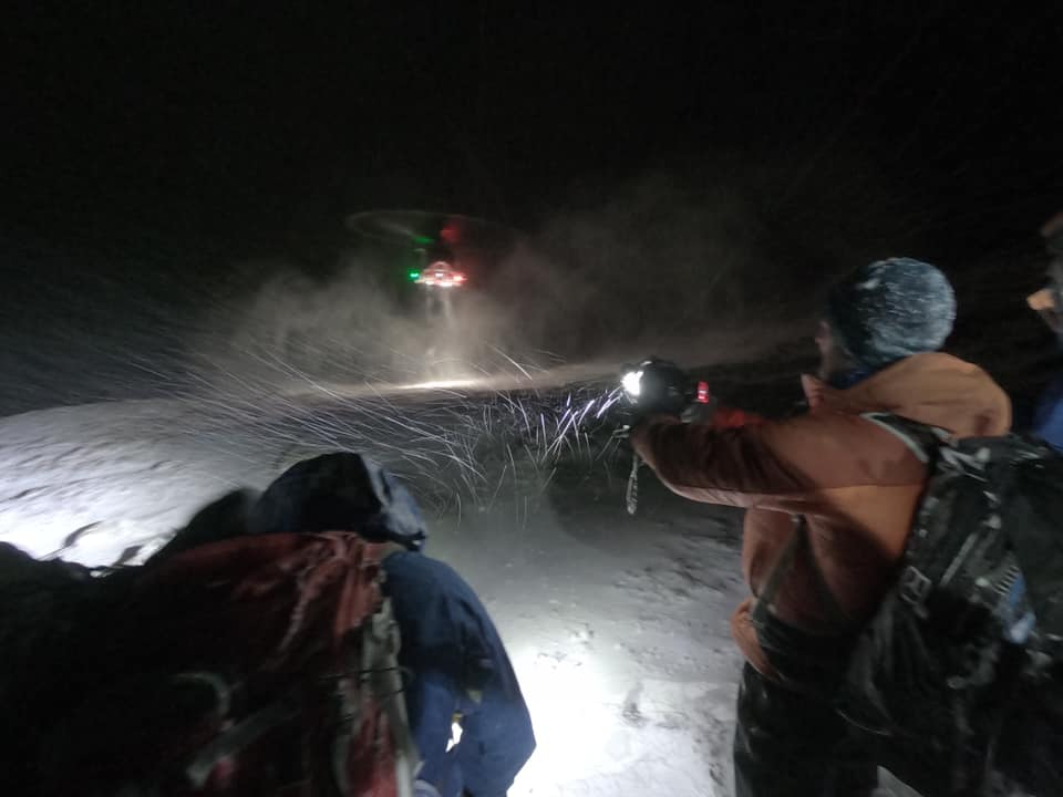 The Coastguard helicopter crew's flying skills were put to the test in the blizzard conditions near the summit. Photograph: LMRT. NO F07 LMRT 01