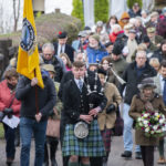 Lochaber High School piper, Ronnie Mcintosh, leads the annual march to the monument for those who lost their lives in the Glencoe Massacre of February 13, 1692. Photograph: Iain Ferguson, alba.photos NO F08 GLENCOE MASSACRE 05
