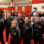 In their smart new tracksuits for smart new surroundings, are club coaches, from left, Vince Lopez, Adam Watson, Emma Lauder, Kevin Kennedy, Stephen Mcmanus (Club Working Official) and Aiden Donnelly. Photograph: Johnpaul Peebles, Abrightside Photography. NO F08 New Boxing Gym opens