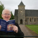 The late Father Tom with a copy of his 2011 book, The Forgotten Cameron of the '45: The Life and Times of Alexander Cameron. NO F09 Father Thomas Wynne with his book