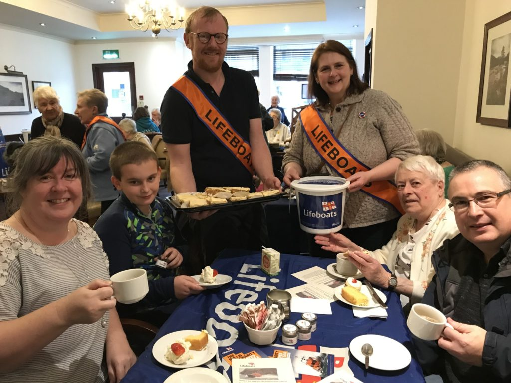 RNLI fundraisers at the helm