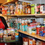 Hope Kitchen's Beth Campbell holds up a typical food parcel. DM_t03_HopeKitchen01