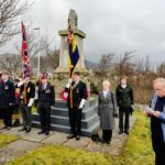 Doug Overfield, far right, cousin of Lt Paul Overfield, with his wife, other relatives and representatives of the Royal British Legion, Bun Sgoil Stafainn, and the Rev Rory MacLeod. Photograph: Staffin Community Trust. NO F10 B17 service