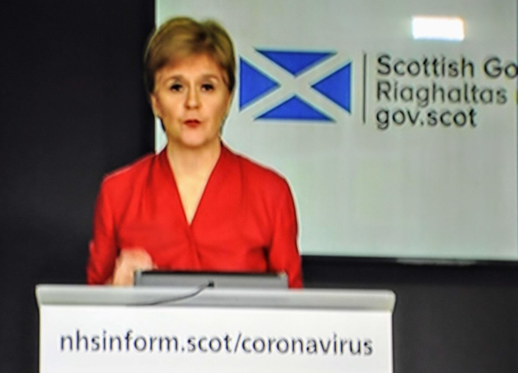Care worker dies of coronavirus, First Minister reveals