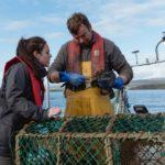 Kate Forbes MSP with Skye fisherman Ian Urquhart. NO F15 KF Ian Urquhart boat