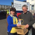 Chris Anne Campbell and Tony Robson with the first batch of visors. NO-F17-western-isles-visors-scaled.jpg
