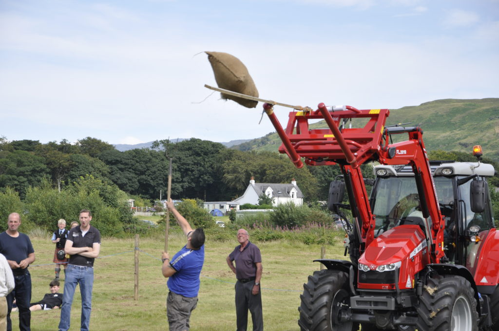 Michael Cameron tossing the hay over the tractor. 15_t32_LornShow16