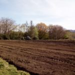 Work underway to get the playing field back into a useable condition. NO F19 tractor ardgour 02