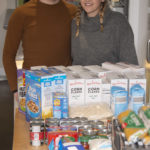 Marianne and Liam Fraser-Stewart with some of the food supplies distributed from 'The Bridge Cafe' in Spean Bridge. Photograph: Iain Ferguson, alba.photos NO F20 lockdown legends_Fraser-Stewart_photograph iain ferguson 01