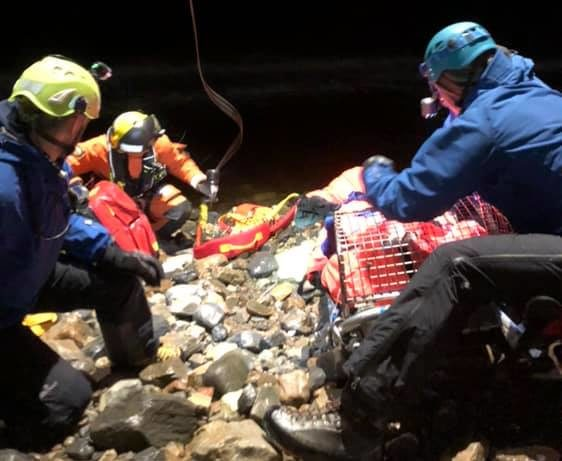 Members of Lochaber Mountain Rescue Team members ready the ill man to be winched aboard a Coastguard helicopter. NO F06 Lochaber MRT rescues off-gridder