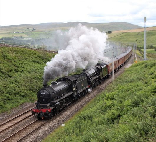 Lord of the Isles, in front, with Lancashire Fusilier as they head for Fort William on Sunday. NO F29 two locomotives