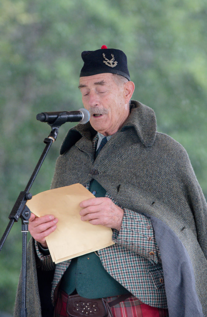 Tearlach MacFarlane making the opening speech as chieftain of the 2017 Glenfinnan Gathering. Photograph: Abrightside Photography. F33 Glenfinnan Games 04JP