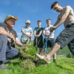 It was hard work in the weekend sun as Fort William FC Director Colin Wood (left) and Scott Hunter (right) with players, committee members and a band of helpers prepare to lay new turf over the improved drainage they have installed at Claggan Park over the last few weeks. Photograph:- Iain Ferguson, alba.photos NO F33 Fort FC Turf 02
