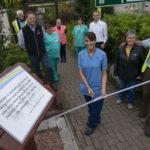 Staff Nurse Jasvir Robertson officially unveils the new dedication board.