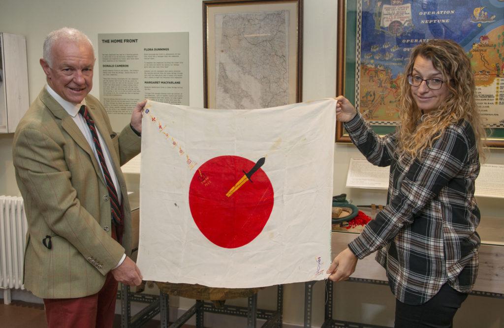 Steve Nicol presents the stitched Japanese flag to Museum Curator, Venessa Martin. Photograph: Iain Ferguson, alba.photos NO F41 Commando donation 01