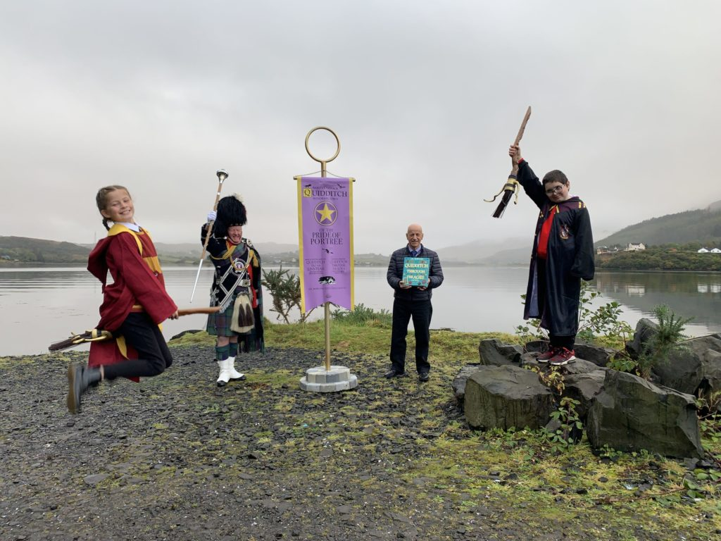 Local councillor John Finlayson was joined by Harry Potter fans, Seamus MacDonald and Eilidh Murray, along with Isle of Skye Pipe Band drum major, Peter MacDonald, for the presentation of the banner on Tuesday. NO F41 quidditch 03