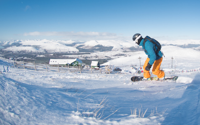 Snowboarder Chris Hawkes from Inverness, hunting for fresh snow heading towards the top gondola station at Nevis Range, Fort William. Photograph: Steve McKenna. NO F06 Nevis Range Feb 19